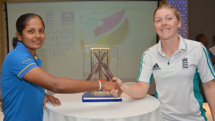Rival captains Inoka Ranaweera of Sri Lanka and Heather Knight of England shake hands in front of the trophy that will be awarded to the winners of the four-match ODI series which starts at the SSC grounds today. (Pic by Malan Karunaratne)