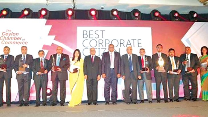 Senior executives of companies that won The Top Ten Corporate Citizens of the Year 2016 with Central Bank Governor, Dr. Indrajith Coomarswamy. Picture by Sudam Gunasinghe.