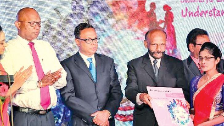 National Savings Bank (NSB) Chairman Aswin de Silva,NSB General Manager and CEO Dammika Perera and officials at the relaunch.  Pictures by Rukmal Gamage