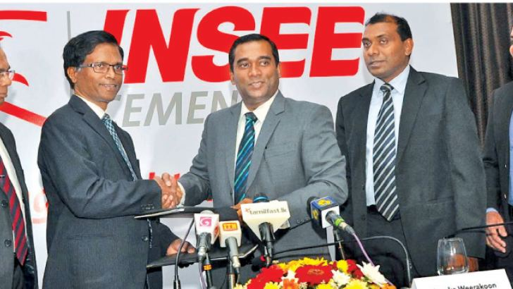 Vice Chancellors Prof. Upul Dissanayaka, Prof. Ananda Jayawardena and  Prof.S.G.N.J. Senanayaka representing the Peradeniya, Moratuwa and Ruhuna  universities with INSEE Cement officials after signing the partnership agreement. Picture by Thushara Fernando