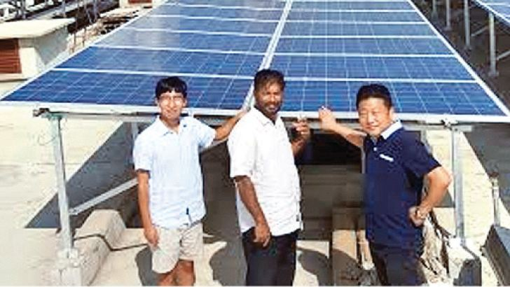 J. J. Construction Chairman  J. J. Lee, White Heaven Hotel Panadura Chairman Sunil Silva with J. J. Construction engineer V. Li on the roof top of the Jie Jie Hotel.  Picture by Shirajiv Sirimane
