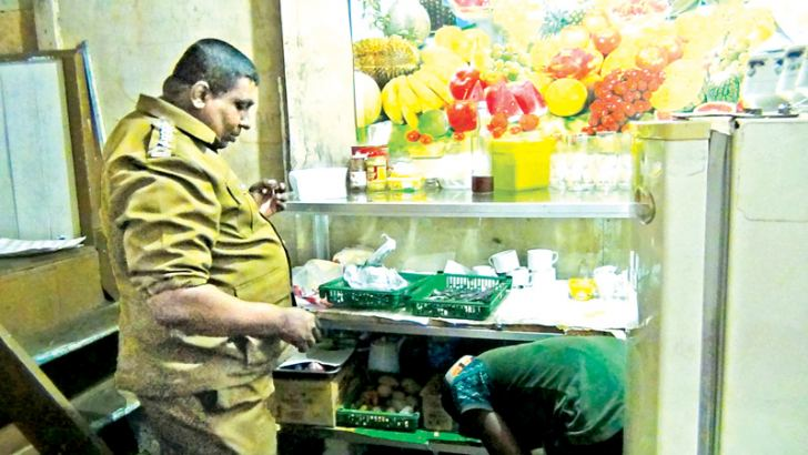 A PHI inspecting food items in an eatery in Nallathanniya