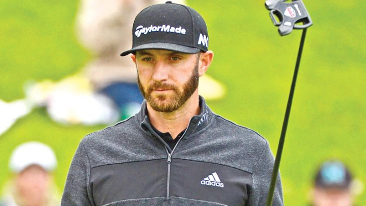 Dustin Johnson reacts to his birdie on the 18th hole during a continuation of the second round at the Genesis Open at Riviera Country Club on February 18. AFP