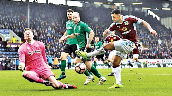 Burnley's Andre Gray has a shot at goal in their FA Cup Fifth round match against Lincoln City at Turf Moor on Saturday