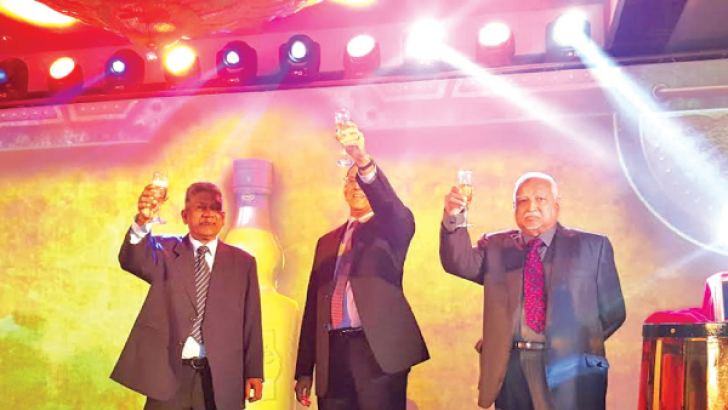 Chairman, DCSL, Harry Jayawardena, Senior Director, Royle Jansz and Master Blender, T. D. Kemon celebrating the 25 years of success at Cinnamon Grand on Saturday.