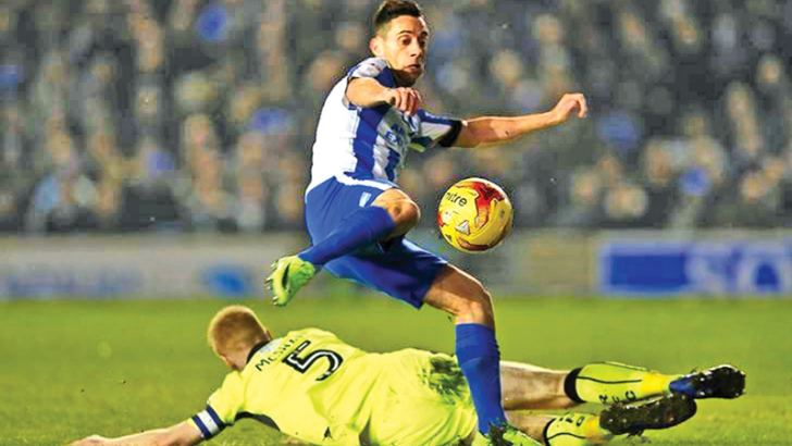 Sam Baldock scores the first goal for Brighton in their Sky Bet Championship match against Reading at American Express Community Stadium on Saturday.