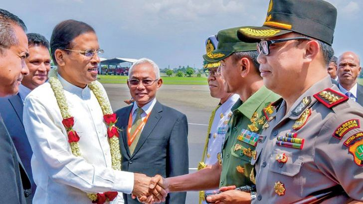 President Maithripala Sirisena arrived at the Jakarta Soekarno-Hatta International Airport yesterday afternoon to attend the Indian Ocean Rim Association Leaders' Summit. He was warmly received by a special delegation, including Indonesian Public Works and Housing Minister Basuki Hadimuljono. President Sirisena will address the Summit today at 11 am Sri Lankan time. Picture by President's Media