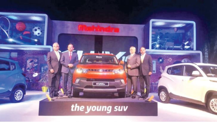 Senior Mahindra officials at the KUV 100 launch last year