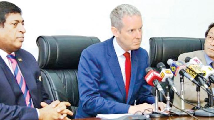 Andrew McDowell, newly appointed Vice President of the European Investment Bank flanked by Finance Minister Ravi Karunanayake and Tung-La Margue, European Union Ambassador to Sri Lanka and the Maldives. Picture by Hirpotha Gunathilaka