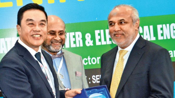 MCIM Director Andrew Siow making a presentation to City Planning and Water Supply Minister Rauf Hakeem while Major Constructors of Sri Lanka CEO Madura Wijeyewickrema looks on. Picture by Wimal Karunathilake