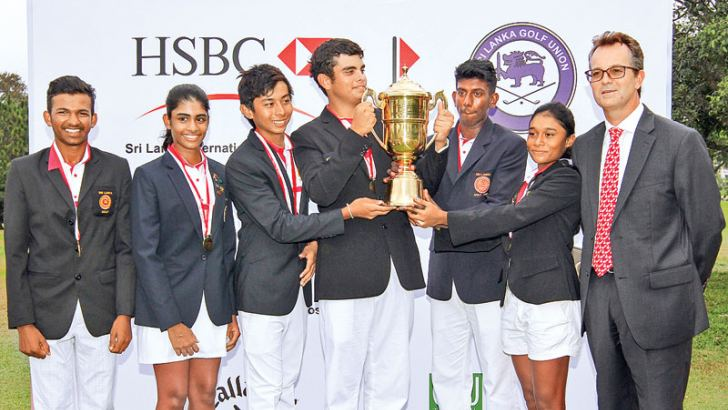 Victorious Sri Lankan team with the trophy and chief guest. from left Thangadorei Akash, Kayla Perera, Vinod Weerasinghe, Armand Flamer Caldera, Januka Dilshan (captain), Taniya Balasuriya and CEO HSBC - Mark Prothero