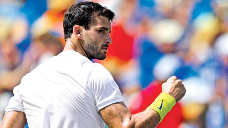 Grigor Dimitrov (ESP) reacts against John Isner (USA) during the Western and Southern Open at the Lindner Family Tennis Center.