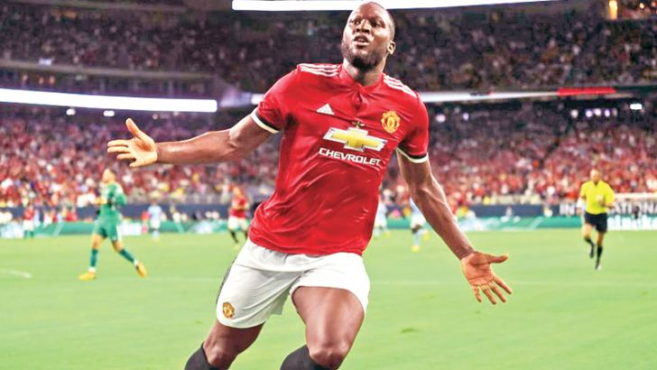 Manchester United's Romelu Lukaku celebrates scoring their second goal in the Premier League match against Swansea at Swansea.