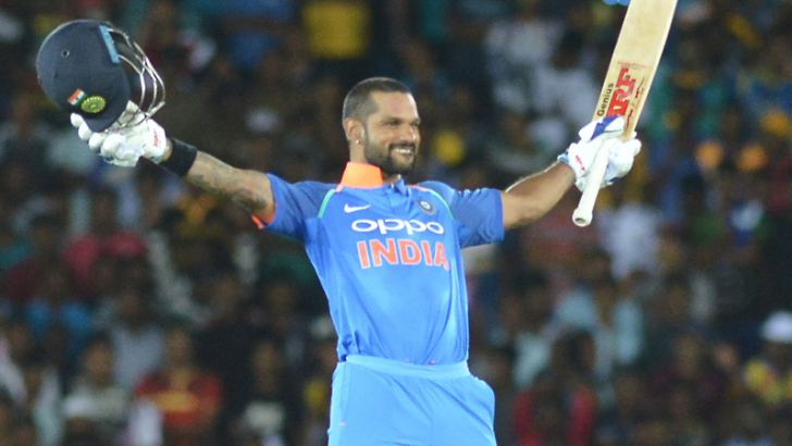 Man of the Match Shikhar Dhawan celebrates his 11th hundred in the first ODI against Sri Lanka played at the Rangiri Dambulla International Stadium yesterday. Pix by Rukmal Gamage