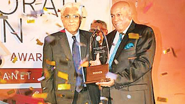 Hayleys Group Chairman Mohan Pandithage accepting the Grand Slam Award at last year's competition
