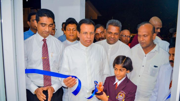 President Maithripala Sirisena opening the new computer laboratory at Royal College. ESOFT Group Managing Director Dr. Dayan Rajapakse is also present