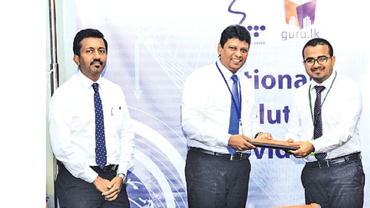 Headstart CEO Hasitha Dela exchanges the agreement with SLT's Group Chief Marketing Officer Ajantha Seneviratne and General Manager Product Development and Management Prabhath Dahanayake.