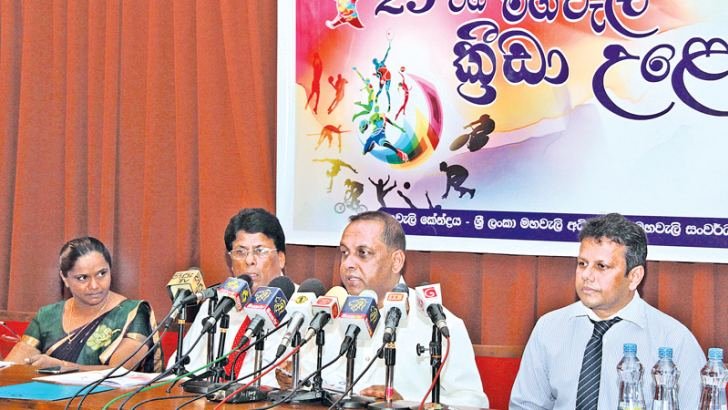Minister of Fisheries and Aquatic Resources and Deputy Minister of Mahaweli Development Mahinda Amaraweera addressing a press conference at the Mahaweli Centre regarding the 29th Mahaweli Games. Mahaweli Director General Gotabaya Jayaratne and Director General of Mahaweli Center Aruna Lekamge are also in the picture. Picture by Kelum Liyanage