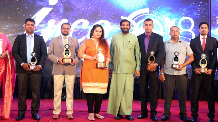 Minister Daya Gamage with the award winners