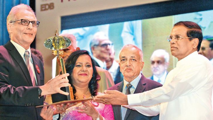 Brandix named Sri Lanka's Exporter of the Year: The Brandix Group was yesterday declared Sri Lanka's No 1 exporter across all industries in 2016 at the Presidential Export Awards presided over by President Maithripala Sirisena. The top award at this annual event was one of five won by the Group for its contribution to the national economy, and was the fifth consecutive Exporter of the Year it has received. Brandix CEO Ashroff Omar is seen receiving the Sri Lankan Exporter of the Year award from the Presiden