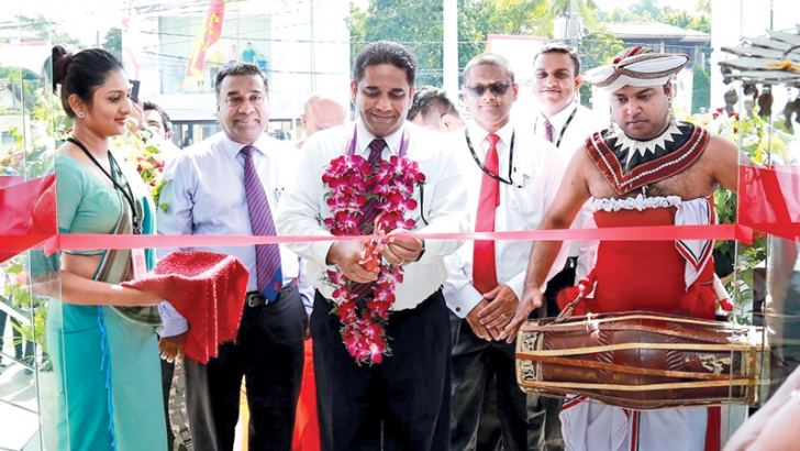 Kapila Ariyaratne, Director and CEO of Seylan Bank opening the branch in Kandana.