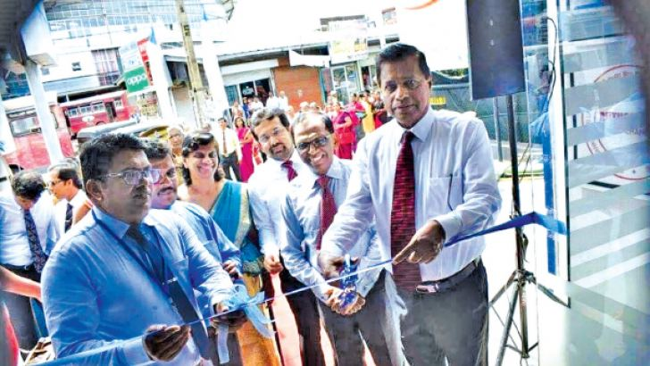 SDB Bank General Manager and Chief Executive Officer Nimal C. Hapuarachchi opening the refurbished Negombo branch.