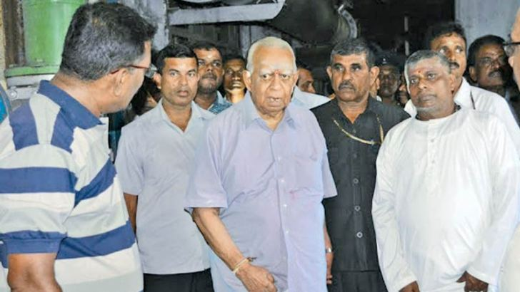 Opposition Leader R. Sampanthan engaging in an inspection tour at the National Paper Corporation factory at Valaichchenai on Saturday along with officials and employees.