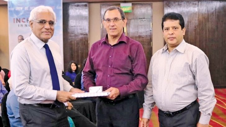 Central Bank Governor Dr. Indrajit Coomaraswamy with DFCC Bank Chairman  Royle Jansz and CEO Lakshman Silva