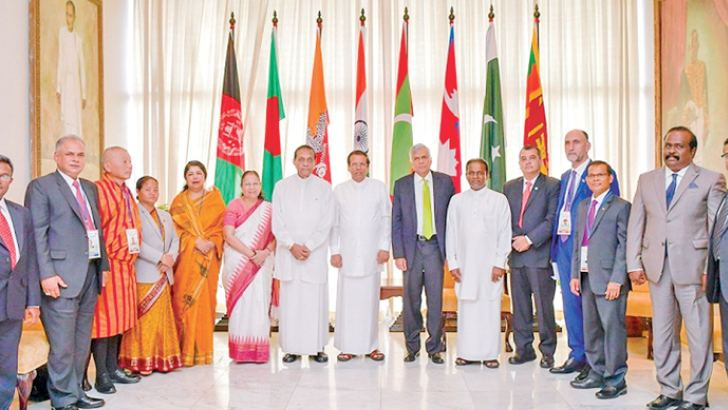 President Maithripala Sirisena and Prime Minister Ranil Wickremesinghe with Speaker Karu Jayasuriya and Speakers of  India, Bangladesh, Bhutan, Maldives, Nepal and Afghanistan with senior parliamentary staff at yesterday's proceedings held to commemorate the 70th anniversary of Parliament Democracy in Sri Lanka. Pictures by Sudath Silva