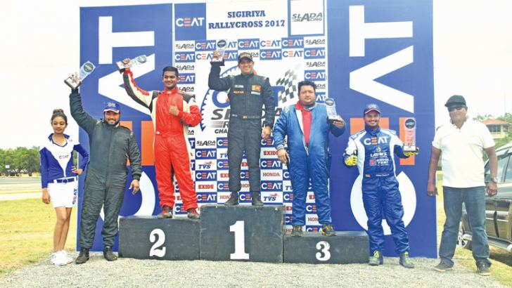 The elite car event brought all past winners to battle grounds once again at Sigiriya. Race 1 podium included four past winners and an emerging driving star. From left - Pasindu Peiris, Kushan Peiris (emerging star) , Ashan Silva, Aravinda Premadasa and Ushan Perera. The other competed past winner Janaka Dias did not make it to the podium.