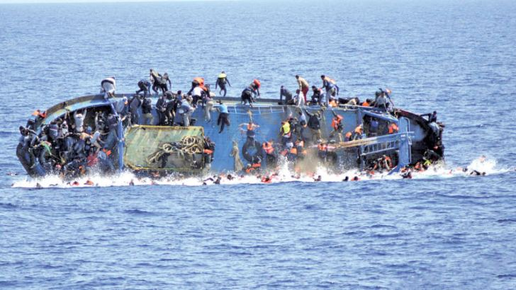Migrants are thrown from a capsizing boat just before an Italian navy rescue operation off Libya.