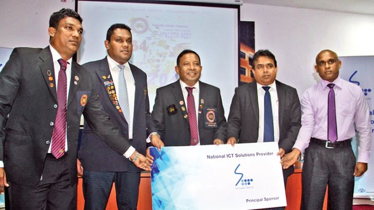 Sri Lanka Telecom Director General, Rohana Ellawala (second from right) handing over the main sponsorship cheque to Mercantile Athletic Federation president Sydney Rathnayake (centre). Others in the picture from left - MAF treasurer Raj Kandaiyah, MAF secretary Tornado Jayasudara and SLT representative. Picture by Udula Peiris