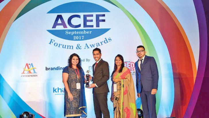 (L-R) Garima Dutt, CSR Lead, GlaxoSmithKline presents the Best Change Management Program of the Year award to Ajmal Hussain, Assistant Manager,  People Development and Culture Transformation, Dialog Axiata PLC, whilst Rekha Weerasooriya, General Manager, Customer Experience Transformation and People Development, Dialog Axiata PLC and Afshaan Mohamed, Senior Executive  Customer Engagement and Communication, Dialog Axiata PLC, look on.