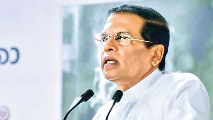 President Maithripala Sirisena speaking on the occasion of the issuing of a felicitation stamp for the late D.B.Dhanapala yesterday. Picture courtesy  President's Media Division