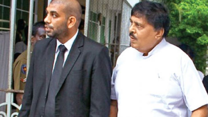Prof. Ananda Samarasekara walking out of the Colombo Chief Magistrate's Court after receiving bail. Picture by Mahinda Vithanachchi.