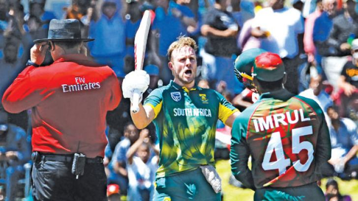 South Africa's AB de Villiers (C) celebrates after scoring a century (100 runs) during the second one day international (ODI) cricket match between South Africa and Bangladesh at Boland Park in Paarl on October 18. AFP