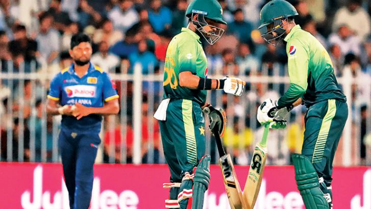 Pakistan's fourth wicket pair Babar Azam and Shoaib Malik hit unbeaten half-centuries in an unbroken century stand to guide their team to victory. AFP
