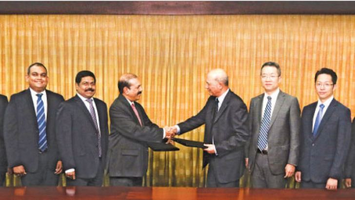 Commercial Bank Deputy Chairman M. P. Jayawardena and Shuan Ghaidan, Director Products, UnionPay International exchanging the agreement in the presence of senior management of the two companies