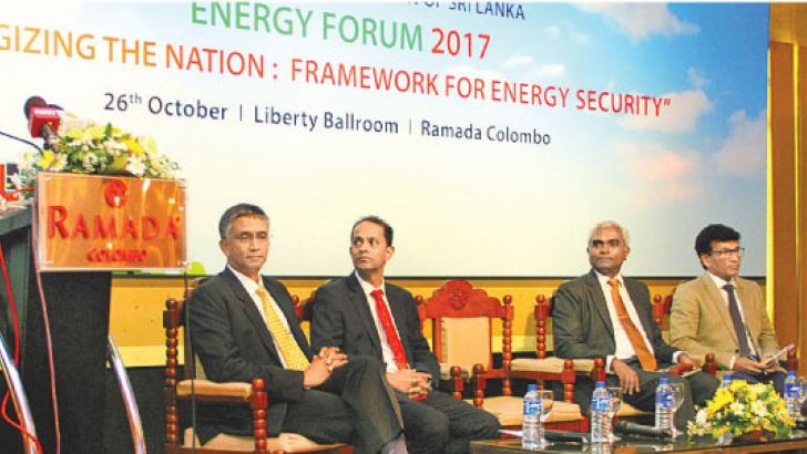 Dr Harsha de Silva: Deputy Minister, Ministry of National Policies and Economic Affairs addressing the Energy Forum. Right: Panel members Thilan Wijesinghe, Chairman, National Agency for Public Private Partnership, Ministry of Finance & Media, Saliya Wickramasooriya, Co Chair of the National Agenda Committee on Energy of the Ceylon Chamber of Commerce and Former Director General of the Petroleum Resource Development Secretariat, Dr Tilak Siyambalapitiya, an energy expert, Damitha Kumarasinghe, Director Gene