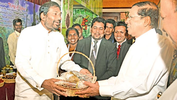 Primary Industries Minister Daya Gamage presents an assortment of pepper to President Maithripala Sirisena.  Picture by Sudath Malaweera