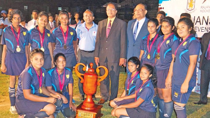 Girls champions, St. Anthony's - Katugastota team with the Trophy. President - SLSHA and the Principal of Dharmaraja College - DampiyaWanasinghe (middle) and officials