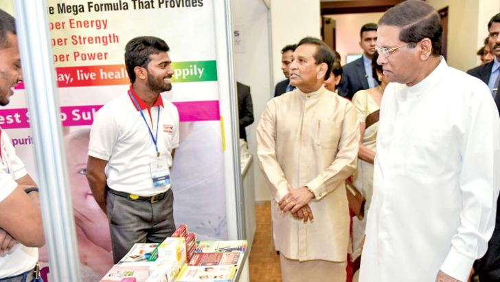 President Maithripala Sirisena, Minister Rajitha Senarathna and others viewing a stall. Picture by President's Media.