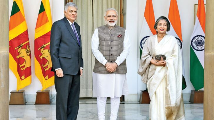 Prime Minister Ranil Wickremesinghe who is on an official visit to India yesterday, called on his Indian counterpart Narendra Modi at Hyderabad House, New Delhi. The Prime Minister with Indian Prime Minister Narendra Modi and Prof. Maithree Wickramasinghe. Picture by Rukmal Gamage