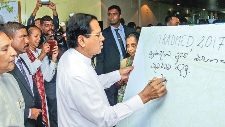 President Maithripala Sirisena inaugurating the Tradmed conference while Health, Nutrition and Indigenous Medicine Minister Dr. Rajitha Senaratne looks on. Pictures by Sudath Silva