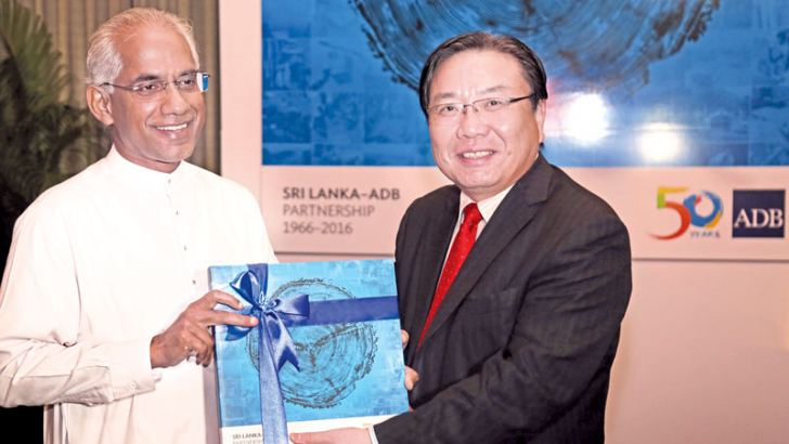 ADB, Vice President Wencai Zhang Presenting the first copies to Minister Eran Wickramaratne and Dr. Harsha de Silva