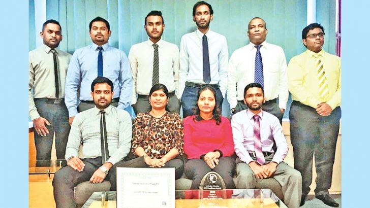NDB's Payments and Settlements - Remittances Team with the award