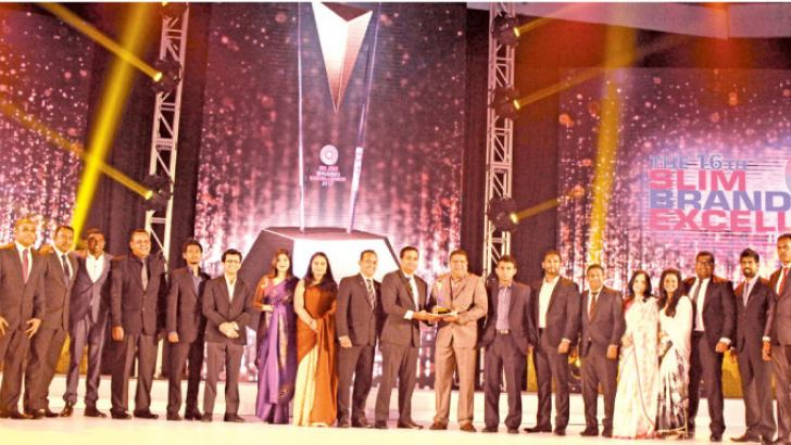 Mobitel receiving the Gold award for 'Service Brand of the Year' at the SLIM Brand Excellence Awards 2017.