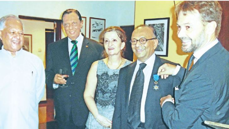 Wicramasinghe  after receiving the Officier de l'Ordre National du Mérite, with French Ambassador, Marian Jean M. Schuh, Tourism Minister John Amaratunga,  Specail Assignments Minister,  Dr. Sarath Amunugama. Picture by Saliya Rupasinghe.