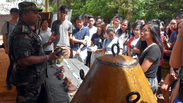 The group of students from Singapore clarifying some after witnessing a mine clearing demonstration at the Security Force Headquarters - Mullaittivu (SFHQ-MLT).