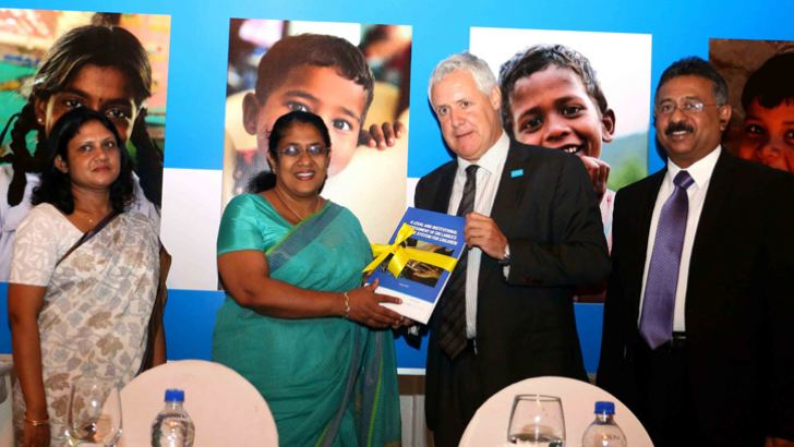 Justice Minister Thalatha Atukorale receiving the report from UNICEF Country Representative Tim Sutton. Picture by Mohamed Imitiyas